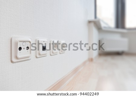 TV Aerial, Telephone and ADSL Socket and European Power in the new flat - stock photo