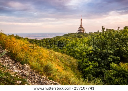 TV and GSM Transmitter at Sunset on Zobor Mountain, Nitra, Slovakia - stock photo