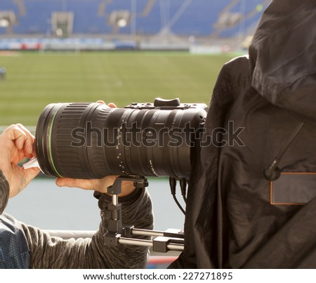 TV at the soccer game Video camera with background of football goal - stock photo