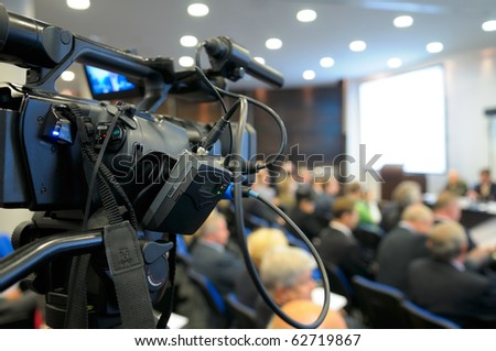 TV camcorder at a conference.