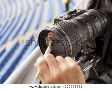TV camera at the soccer game  - stock photo