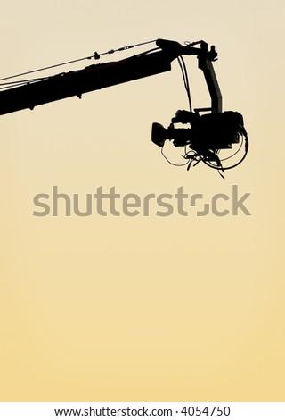 TV camera on a crane - stock photo