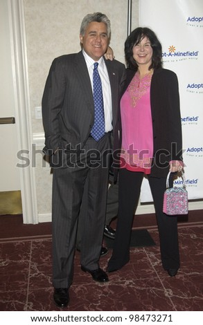 TV chat show host JAY LENO & wife at the 3rd Annual Adopt-A-Minefield Benefit Gala at the Beverly Hills Hilton. Sept 23, 2003  Paul Smith / Featureflash - stock photo