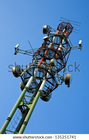 TV communication tower on summer blue sky
