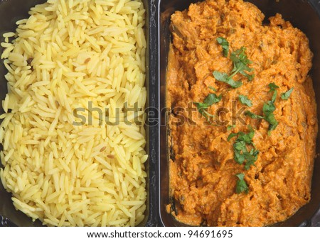 TV dinner Indian curry with rice - stock photo
