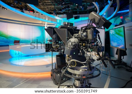 TV NEWS cast studio with camera and lights - stock photo