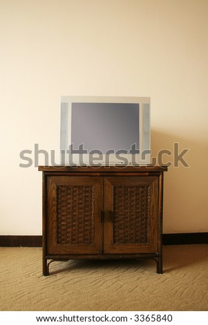 tv on cabinet - stock photo