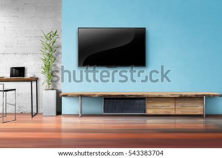 Tv on light blue wall wooden imagen de archivo stock 543383704 tv on light blue wall with wooden table and plant in pot empty living room interrior aloadofball Gallery