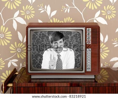 tv presenter mustache man in wooden retro television brown wallpaper [Photo Illustration] - stock photo