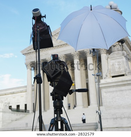 TV production set with camera and lighting equipment on tripods in front of Supreme Court building with in Washington D.C. - stock photo