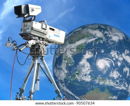 TV Professional studio digital video camera over blue sky and Earth concept - stock photo