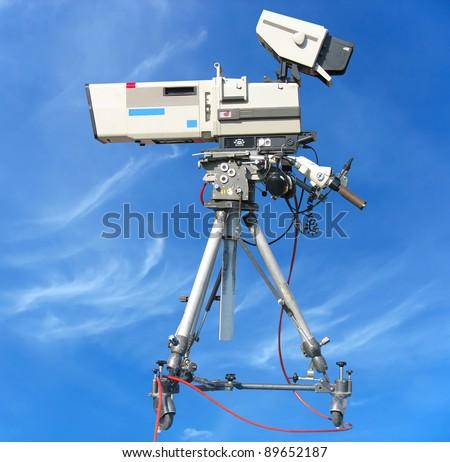 TV Professional studio digital video camera over blue sky background - stock photo