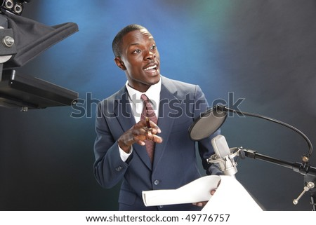 TV/Radio news anchor with prompter and microphone - stock photo