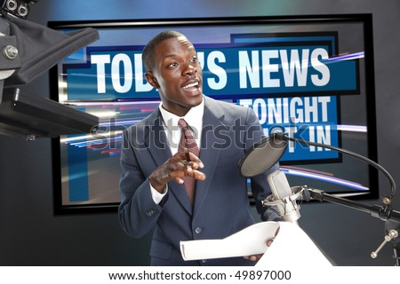 TV/Radio news anchor with prompter and microphone. Includes clipping path so you can change the screen graphics. - stock photo