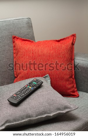 TV Remote control on couch - stock photo