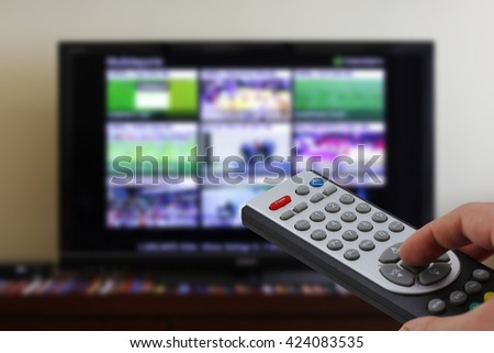 Tv remote control, television with sports menu