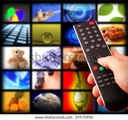 tv remote control towards the television - stock photo