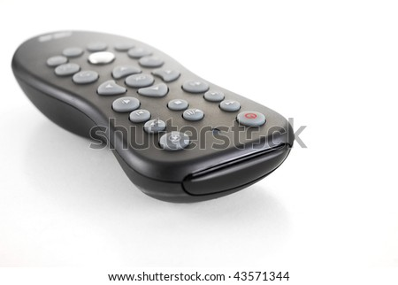 Tv remote with reflection on white background - stock photo