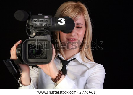 TV reporter with video camera making reportage