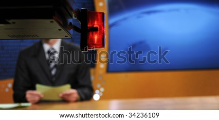 TV studio shallow DOF, focus on the red lamp - on Air sign - stock photo