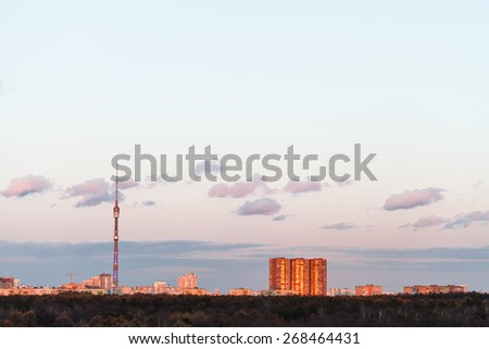 TV tower and urban buildings in pink spring sunset, Moscow