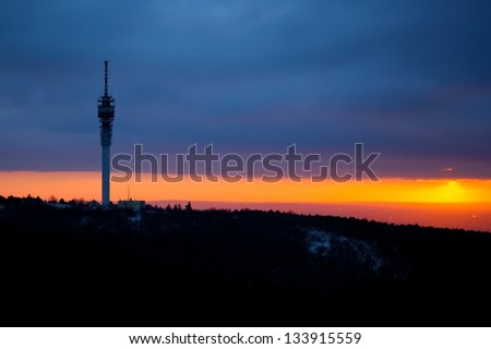 TV tower on top of the hill at cloudy sunrise