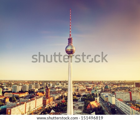 Tv tower or Fersehturm in Berlin, Germany at sunset - stock photo
