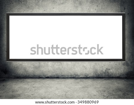tv winh blank screen hanging on a grunge wall - stock photo