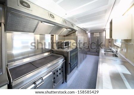 TVER - JUN 05: The kitchen furnishings in the train, on June 05, 2013 in Tver, Russia. - stock photo