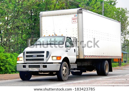 TVER REGION, RUSSIA - MAY 22, 2013: White Ford F650 truck at the interurban road. - stock photo