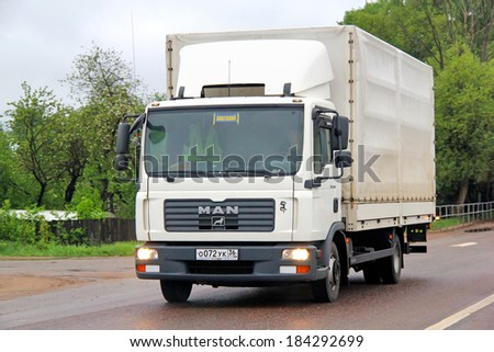 TVER REGION, RUSSIA - MAY 22, 2013: White MAN TGL truck at the interurban road.