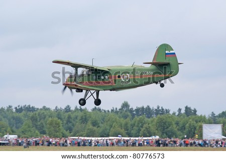 TVER, RUSSIA - JULY 09: Antonov An-2 multipurpose biplane lands during the Tver Blue Skies aviation festival on July 09, 2011 in Tver, Russia