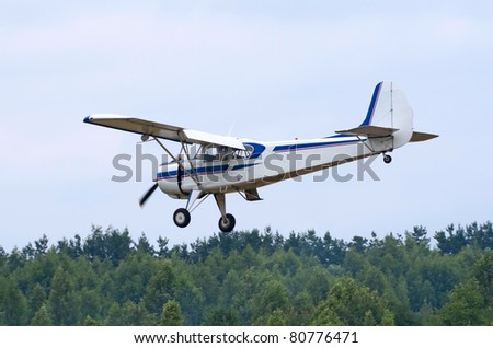 TVER, RUSSIA - JULY 09: Yak-12 plane flies low during the Tver Blue Skies aviation festival on July 09, 2011 in Tver, Russia