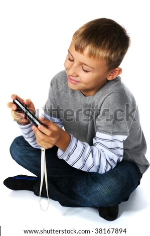 tween boy with psp sitting - stock photo
