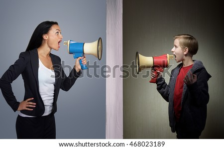 Tween son and his mother shouting through the megaphones at each other
