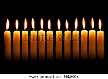 Twelve alight candles over the black background - stock photo