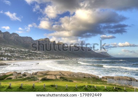 Twelve Apostles Mountain Range and Camps Bay near cape Town in South Africa. Camps Bay is an affluent suburb of Cape Town, South Africa. In summer it attracts a large number of foreign visitors. - stock photo