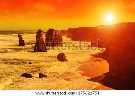 Twelve Apostles, natural landmark near the Great Ocean Road at dramatic sunset. Victoria, Australia - stock photo