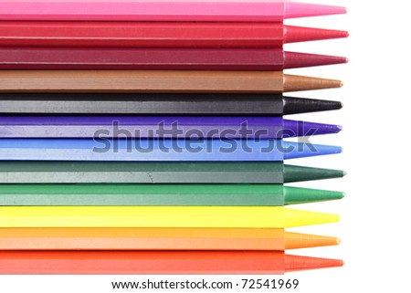 twelve color crayons lie over white background - stock photo
