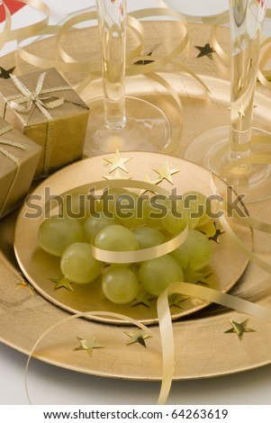 Twelve grapes of luck and New Year's Eve decoration - stock photo