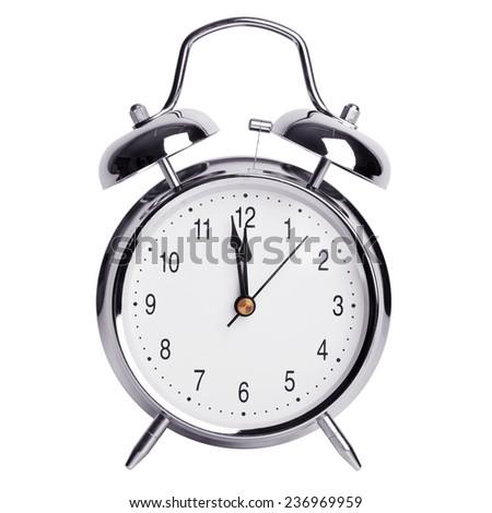 Twelve hours on a round alarm clock - stock photo