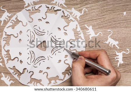 Twelve monkeys. Snowflake, with monkeys, carved out of paper - stock photo