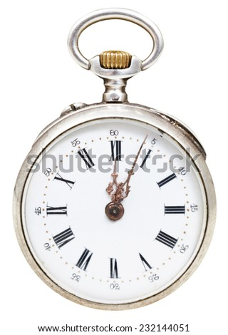 twelve o'clock and five minutes on the dial of retro pocket watch isolated on white background