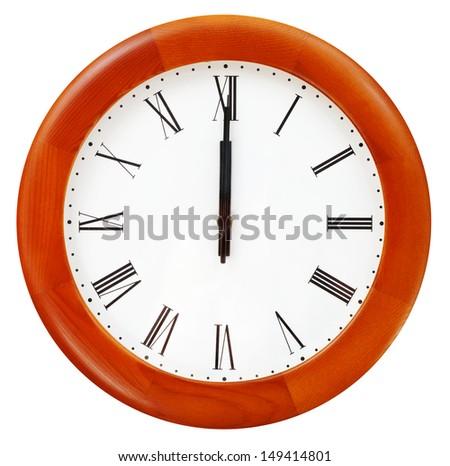 twelve o clock midnight on the round wall clock - stock photo