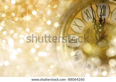 Twelve o'Clock on New Year's Eve in colored gold - stock photo