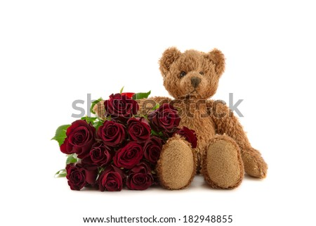 Twelve red roses and cuddly teddy bear.