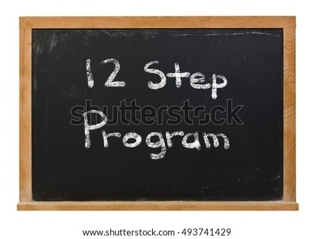 Twelve step program written in white chalk on a black chalkboard isolated on white