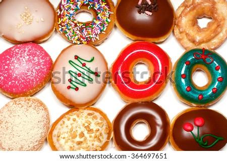 Twelve various doughnut in the white paper box - stock photo
