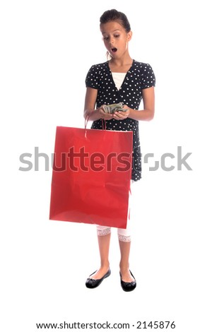Twelve, 12 year old girl with a big red shopping bag with an amazed expression at the loads of cash she has saved - stock photo