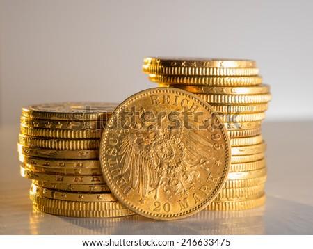 Twenty Deutsch Mark gold coins - stock photo